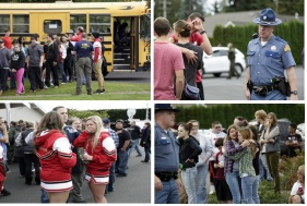 Students exit a bus with an FBI agent speaking to students as they arrive at Shoultes Gospel Hall church after a student opened fire at Marysville-Pilchuck High School in Marysville, Washington